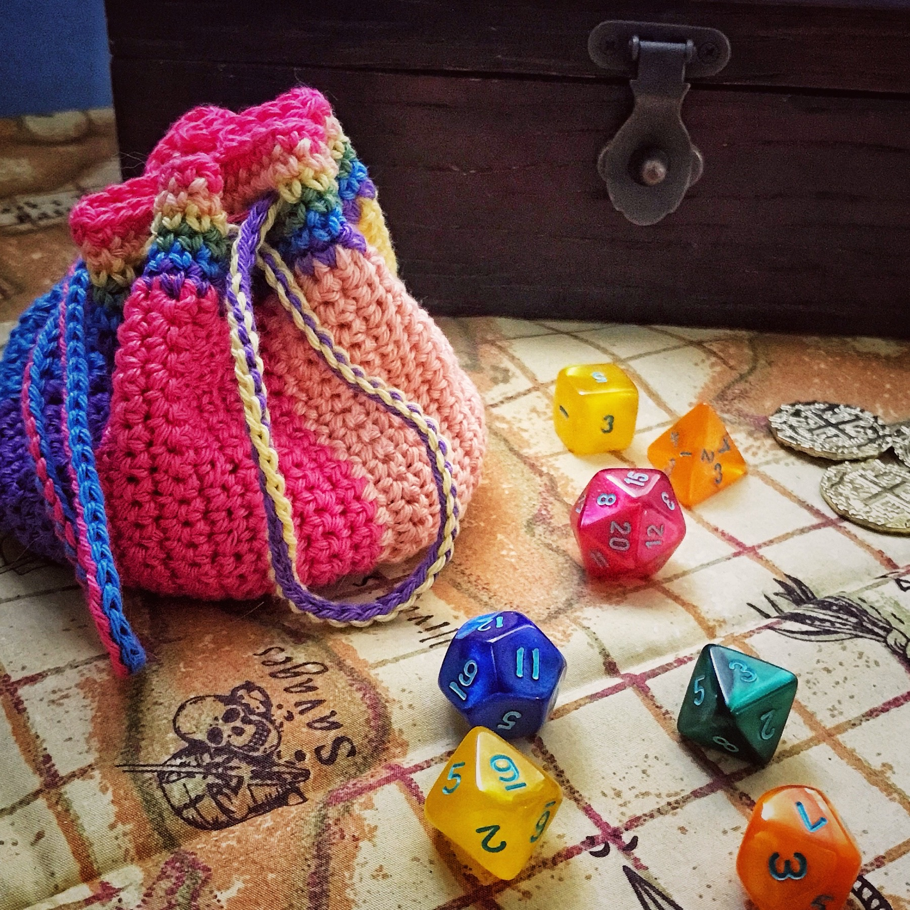 rainbow dice pouch on a pirate map